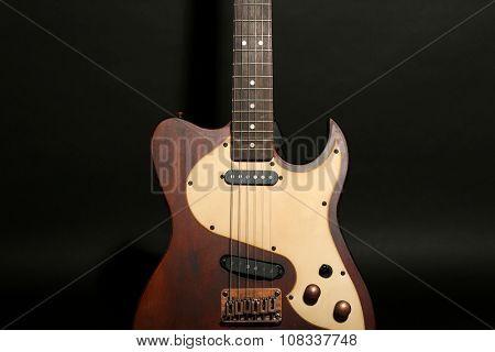 Electric guitar on dark grey background