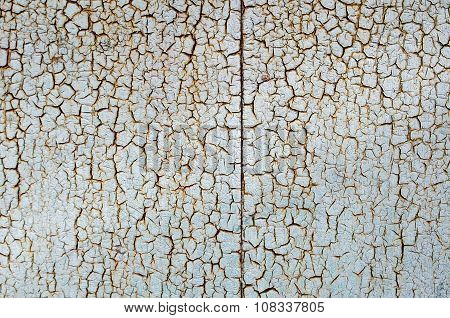Rusty Metal Surface Is Covered With A Thick Layer Of Paint