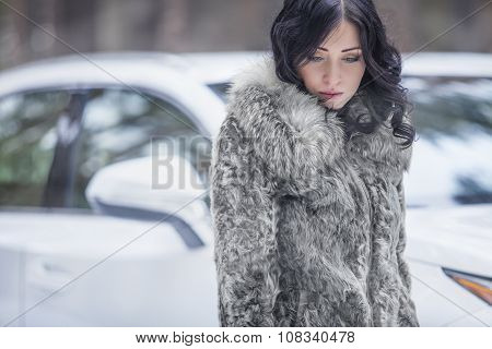 Beautiful Female Model Tender In The Fur On The Background Of Auto