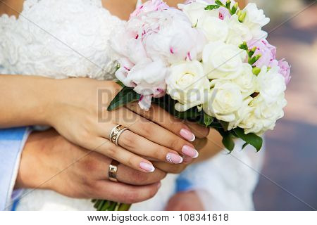 Vintage wedding bouquet in the hands of men and women