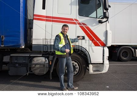 Logistics - Proud Driver  With Tablet Computer, In Front Of Trucks .