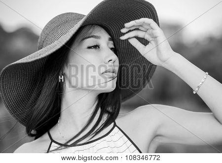 woman in wide hat