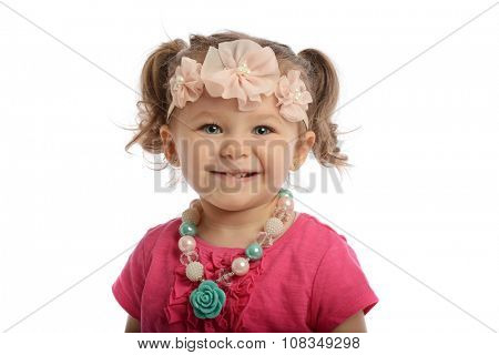Little girl smiling isolated o a white background