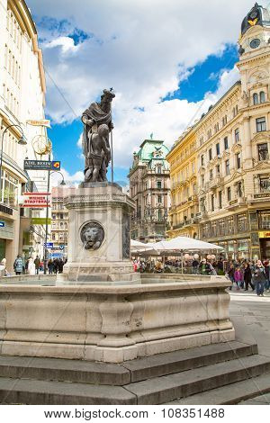 Fountain,  street view, people in the center of Vienna, Austria