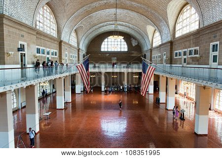 NEW YORK - SEPTEMBER 02: Overview of Tourists in Great Hall of Ellis Island Immigration Museum - Historic Location Where New Immigrants Were Processed - New York City, USA. September 02, 2015.