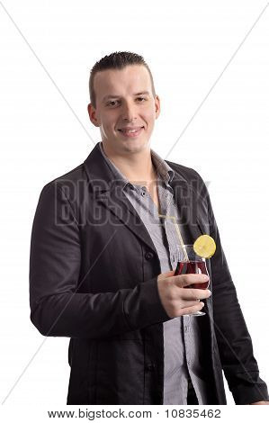 Young Man Drinking A Cocktail