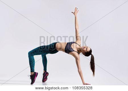 Beautiful Dancer Doing Bridge Exercise