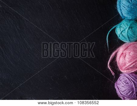 Colored Clew On Slate Background With Copyspace
