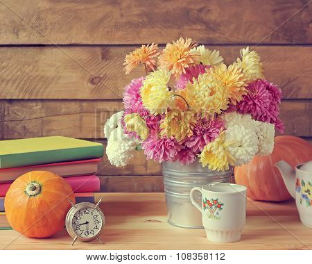 Still Life With Chrysanthemums, Pumpkins, Ware, Books And An Alarm Clock.