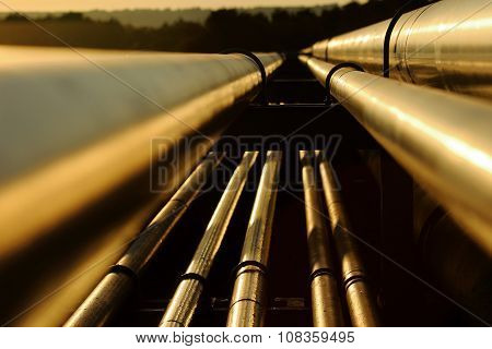 Close Up View Of Steel Golden Pipes In Refinery