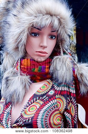 Closeup Of A Woman Mannequin In A Winter Fur Hat