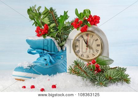 New Year clock with blue shoe and fir branches