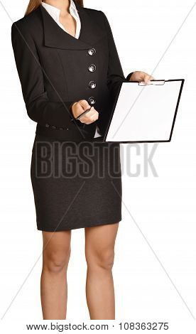 woman headless holding a pen and clipboard