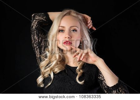 Blonde Model In Lace On The Black Background