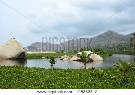 View To Lagoon And Hills Covered With Green Tropical Vegetation
