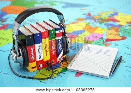 Learning languages online. Audiobooks concept. Books and headphones on the map world. 3d