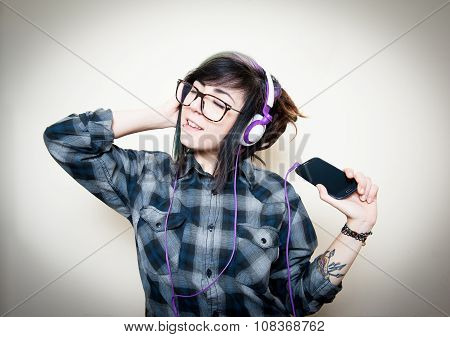 Pretty Young Woman Happy While Listening Music