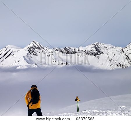 Freerider On Off-piste Slope In Mist And Warning Sing