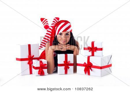 Santa Girl Is With A Bunch Of Gifts. Holidays Christmas And New Year.