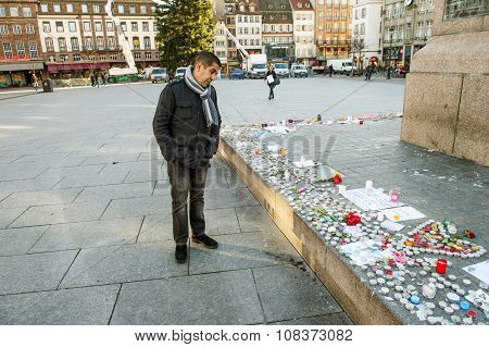 Looking At Messages, Candles And Flowers In Memorial For The Victims