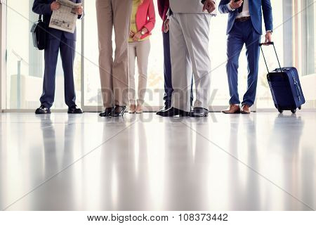 Close up of legs of business people