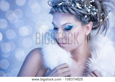 Snow Queen with fur over winter background
