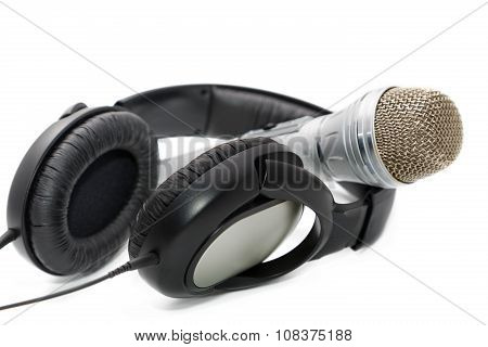 Microphone And Ear-phones On A White Background