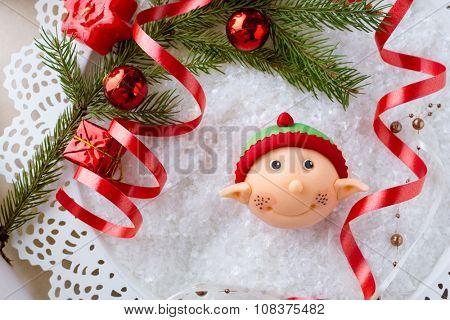 Santa helper  cupcake over decorative background