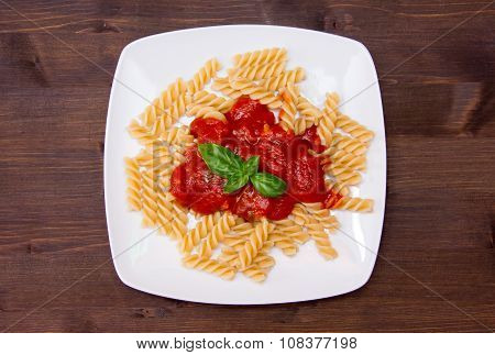 Fusilli with tomato sauce on wood from above