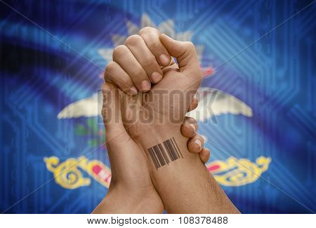 Barcode Id Number On Wrist Of Dark Skinned Person And Usa States Flags On Background - North Dakota