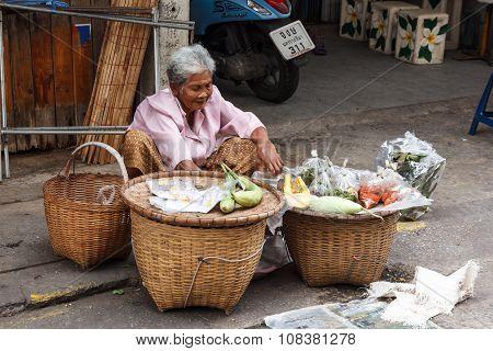 Monger Sitting Selling On Sidewalk