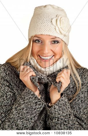 Portrait of beautiful blond woman in warm clothes on blue background
