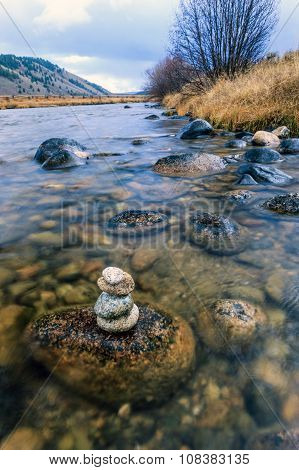 Stacked Rocks In The River.
