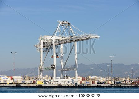 Oakland, CA - March 9, 2015: Oakland container shipyard after strike, with ships delivering merchandise.