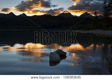Two Rocks In Lake At Sunset.