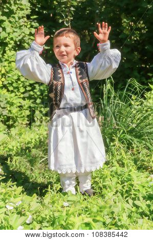Romanian Child Dressed In A Traditional Costume