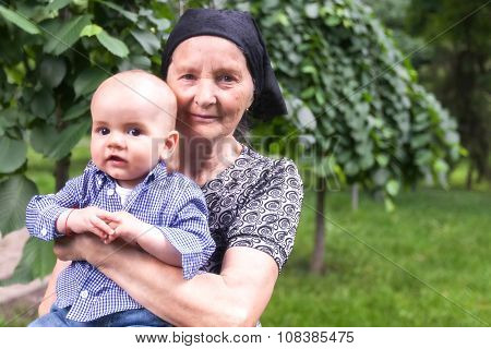Happy Grandmother With Her Baby Grandson