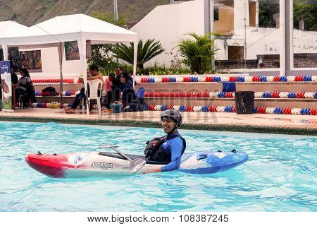 Hispanic Man Competes At The Canoeing Contest