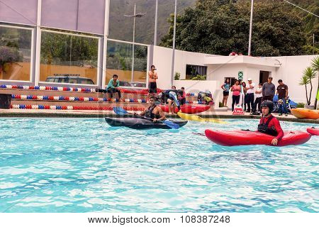 Group Of Men Competes At The Canoeing Contest