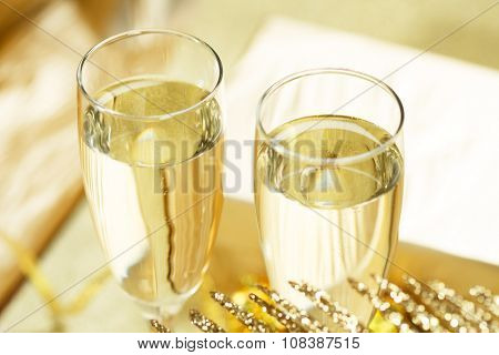 Two champagne glasses with gift boxes