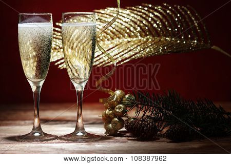 Two champagne glasses on wooden table