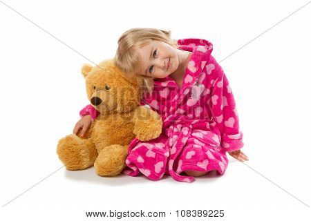 Little Girl In Warm Pink Bathrobe With Teddy Bear  On A White Background.