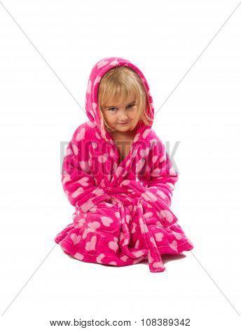 Little Girl In Warm Pink Bathrobe  On A White Background.