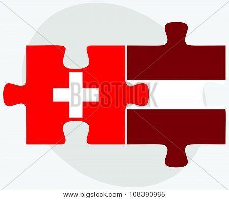 Switzerland And Latvia Flags