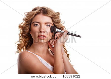 Girl With Curly Hair Straightens Makeup Brush.