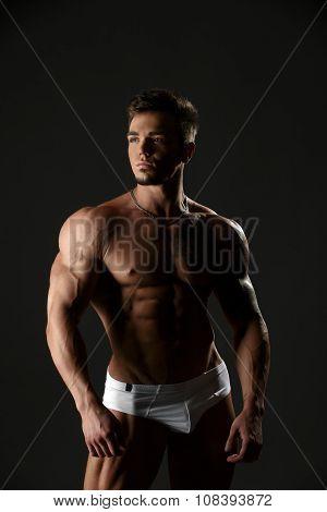 Handsome muscular male model posing in underwear