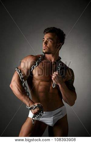 Male model posing with chain wrapped around neck