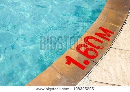 Swimming pool with Number 1.60 on ground at hotel