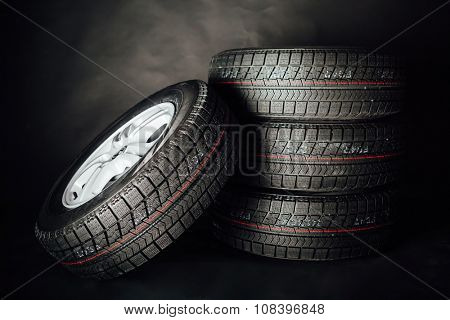 studless winter tires, black background