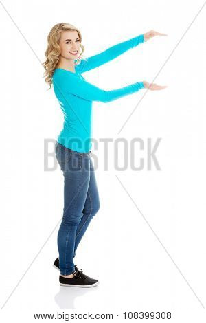 Woman showing something or copyspase for product or sign text